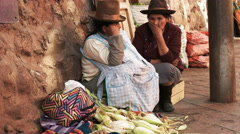 Two women sell corn at a street market in cusco Stock Footage