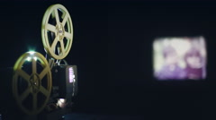Old movie projector showing film Arkistovideo