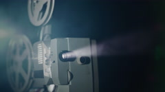 Old film projector working in dark space Stock Footage