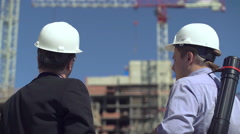 Developers are talking on construcrion site - stock footage