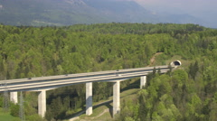 AERIAL: Big highway viaduct leading into the tunnel under the mountain Stock Footage