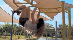 Young girl on the playground in the park. Stock Footage