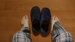TOP VIEW: Man gets up from a bed in the night then wears a slippers and goes Stock Footage