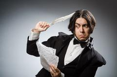 Funny writer with quill in vintage concept - stock photo