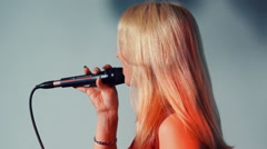 Woman Singer with microphone. Stock Footage
