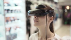 Young woman getting experience in using vr-headset in a mall. Close up Stock Footage