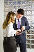 Young business couple using tablet in the office Stock Photos