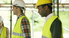 4K Builders working at construction site with female architect looking at plans Arkistovideo