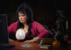 Clairvoyant using big crystal egg for scrying online Stock Photos