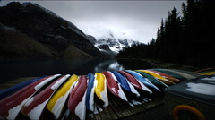Snow, lake , mountains, canoes, Banff, Canada Stock Footage