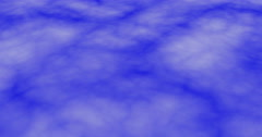 Dense clouds moving fast downwards direction, against blue background Stock Footage
