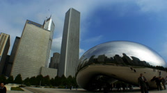 Skyscrapers and Cloud Gate sculpture, downtown Chicago, IL Stock Footage