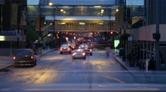City traffic and L train downtown Chicago, IL Stock Footage