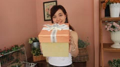 Portrait of thai women adult beautiful girl hold gift box in hands - stock footage
