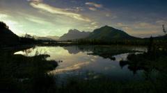 Lake reflecting Rocky Mountains, Banff, Canada Stock Footage
