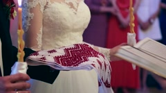Wedding in the church, bride and groom. Wedding ceremony. Bride and groom with Stock Footage