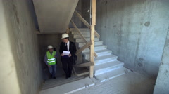Foreman and architect going upstairs Stock Footage