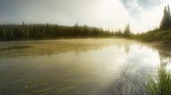 Lake reflecting forest and mountain, Mount Rainier National Park, Washington Stock Footage
