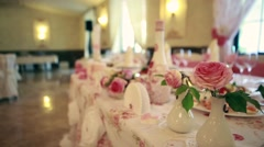 Wedding. Banquet. The chairs and table for guests, decorated with candles Stock Footage