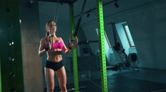 Fitness dip ring girl workout at gym - stock footage