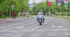 Policeman on a motorcycle is driving through the streets Stock Footage