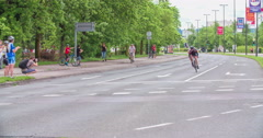 A man on a bicycle is driving ahead of everyone else Stock Footage