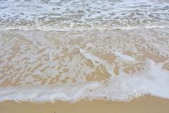 Wave ripples on sandy beach. Stock Photos