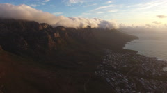 Aerial of Camps Bay, Cape Town in Golden Sunset Stock Footage