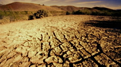 Dry, cracked earth during summer drought Arkistovideo