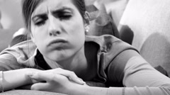 Woman unable to sleep on sofa getting annoyed black and white 4K Stock Footage