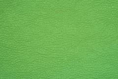 Green leather background texture closeup Stock Photos