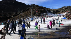 Snow skiers in Whakapapa skifield on Mount Ruapehu Stock Footage