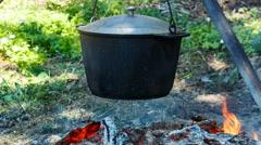 smoked tourist pot over camp fire. correct angles of rake. - stock footage