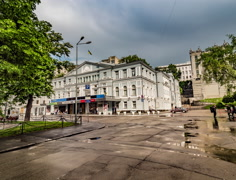 Walkers Near Franko Theater Kiev Ukraine Horodecki House Chimaeras on Kiev Day Stock Footage