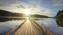 Pond and dock reflecting sky, Oregon Stock Footage