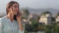 Beautiful Young Professional Woman Has a Telephone Conversation on the Roof of Stock Footage