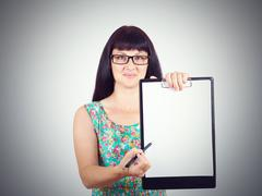 Woman holding a blank document pointing where to put signature Stock Photos