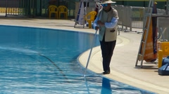 Workers swimming pool cleaning Stock Footage