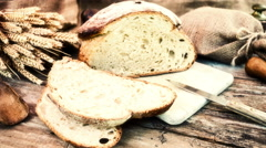 Freshly baked bread in rustic setting. Slider shot. 4k Stock Footage