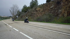 Two Bikers On Racing Bikes On Empty Road Stock Footage