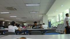 Shenzhen, China: people in reading Stock Footage