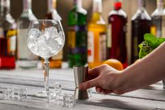 Wineglass with ice and jigger. - stock photo