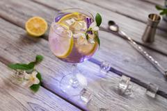 Cocktail decorated with small flower. - stock photo