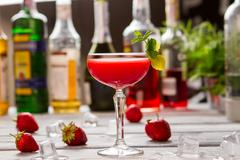 Red drink in a glass. Stock Photos