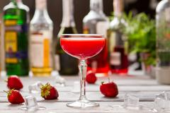 Red beverage in a glass. Stock Photos