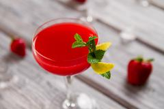 Bright red beverage in glass. Stock Photos