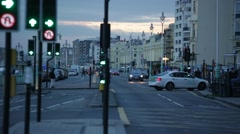 Traffic at dusk by the sea in Brighton Stock Footage