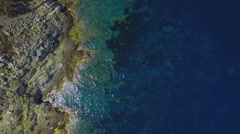 Beautiful cliffs scenic aerial shot - flying over rocks and water Stock Footage