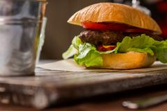 Hamburger with lettuce leaves. Stock Photos