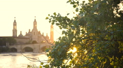 Sunset On the River In Zaragoza With Our Lady of the Pillar Basilica On The Stock Footage